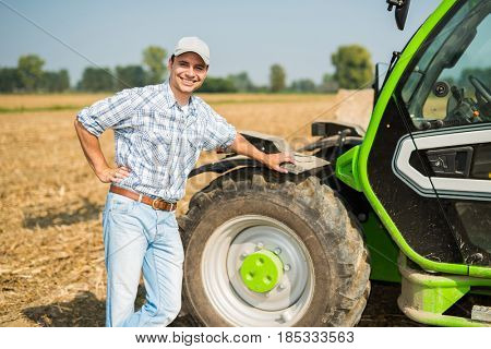 Smiling farmer at work in his field