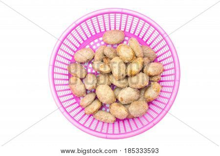 Seed of sweet Marian plum fruit sun bath to keep farming in plastic basket isolated on white background