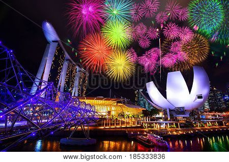 SINGAPORE - FEB 9 2017 : Singapore cityscape and firework at night in Singapore.