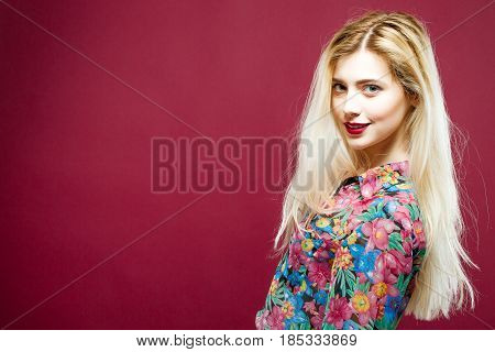 Coquettish Blonde with Sensual Lips in Colorful Shirt on Pink Background. Portrait of Amazing Woman with Long Hair in Studio.