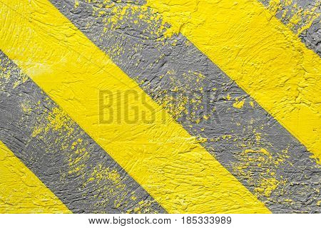 Background yellow-gray warning stripes. Warning of danger