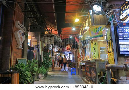 SHANGHAI CHINA - NOVEMBER 2, 2016: Unidentified people visit Tianzifang. Tianzifang is a touristic arts and crafts enclave in traditional residential area of French Concession.