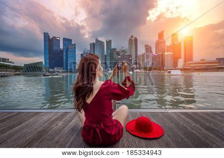 Young woman take a photos in Singapore.
