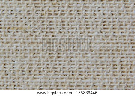 Gently beige pronounced texture of the fabric with clearly visible fibers