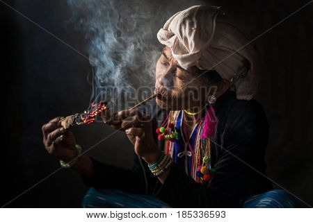 Chiang Mai, Thailand - Jul 25 : Karen Hill Tribe Is Smoking Tobacco Pipe With Traditional Clothes An