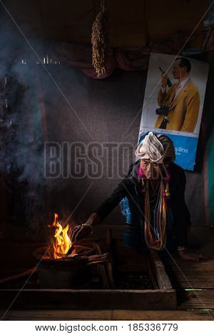 Chiang Mai, Thailand - Jul 25 : Karen Hill Tribe In Her House With Traditional Clothes And Dramatic
