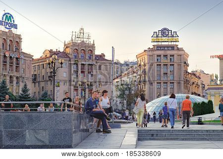 Kiev, Ukraine - September 11, 2016: Maidan Nezalezhnosti Independence Square at weekend in Kiev. People walking and relax through square passing cafes restaurants and shops