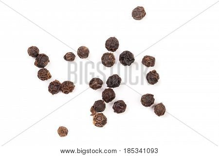 Black peppercorn isolated on white background. Top view.