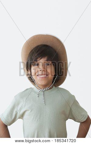 Boy wearing cowboy hat