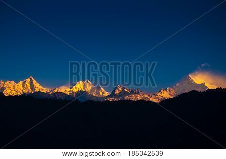 The majestic Kanchenjunga range of the himalayas at first light of sunrise at Sikkim India