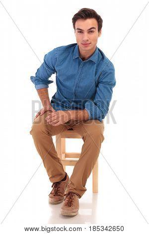 full body picture of a seated casual man  on white background