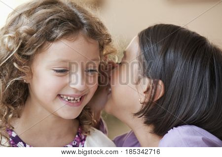 Mixed race girls telling secrets
