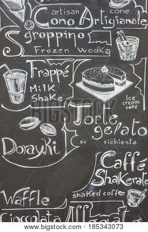 Typical italian menu written on a black chalkboard to mean a concept of tourism and business