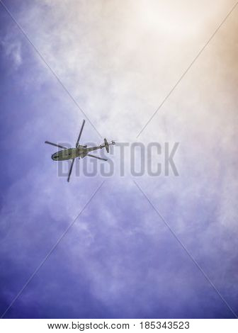 Helicopter flying againts with the blue sky