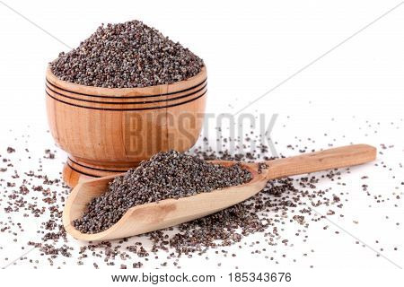 poppy seeds in a wooden bowl and scoop isolated on white background.