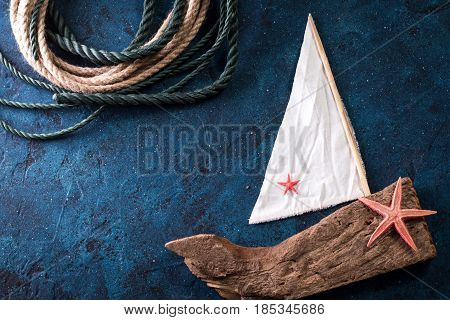 Summer Time Sea Vacation Background With Star Fish, Marine Rope And Boat On Dark Blue Background