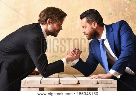 Business Competition. Two Serious Businessmen Arm Wrestling