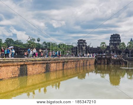 Siem Reap Cambodia - October 30 2016: Tourists visit Angkor Wat UNESCO World Heritage site in Cambodia