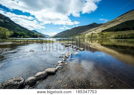 Stepping stones at Loch Doine in the Trossachs National Park, Scotland