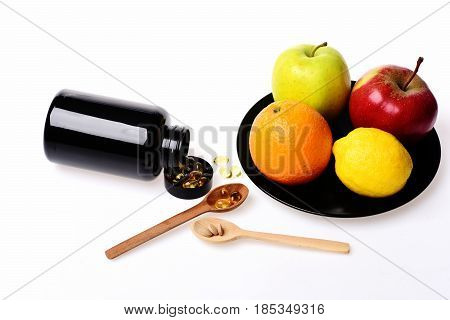 Fresh Fruit And Fish Oil In Plastic Bottle, Wooden Spoon