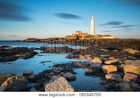 Long Exposure at St Mary's Island - St Mary's Lighthouse on the small rocky St Mary's Island just north of Whitley Bay on the North East coast of England. A concrete causeway submerged at high tide links it to the mainland