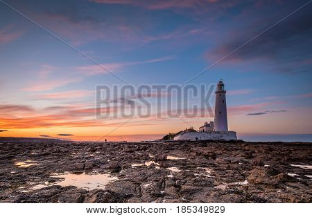 Dusk at St Mary's Lighthouse - St Mary's Lighthouse on the small rocky St Mary's Island just north of Whitley Bay on the North East coast of England. A concrete causeway submerged at high tide links it to the mainland