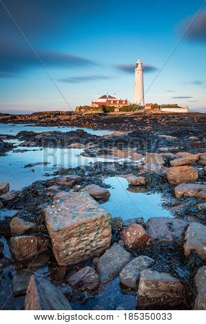 St Mary's Lighthouse in portrait - St Mary's Lighthouse on the small rocky St Mary's Island just north of Whitley Bay on the North East coast of England. A concrete causeway submerged at high tide links it to the mainland