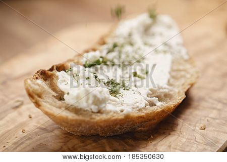 herbs on rustic bread with ricotta cheese, shallow focus