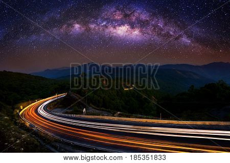 Milky Way And Car Light On Road At Doi Inthanon National Park In The Night, Chiang Mai, Thailand.