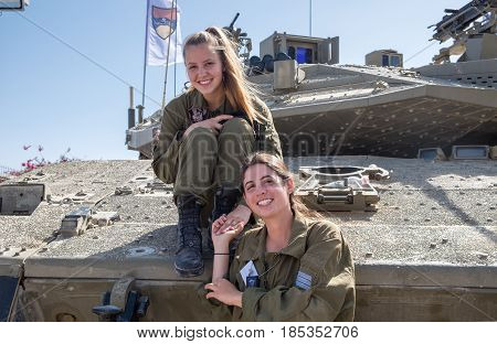 Unidentified Israeli Girls Soldiers Sit On Tank Armor At Latrun Armored Corps Museum