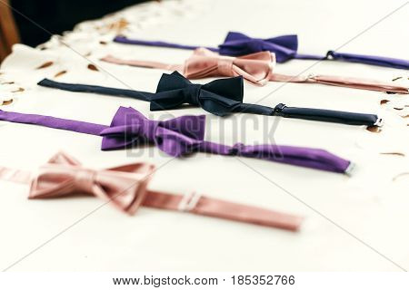 Stylish Bow Ties On White Background With Space For Text. Groom And Groomsmen Getting Ready In Morni