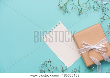 Kraft Paper Gift Box Tied With White Ribbon And Flowers For Mothers Day