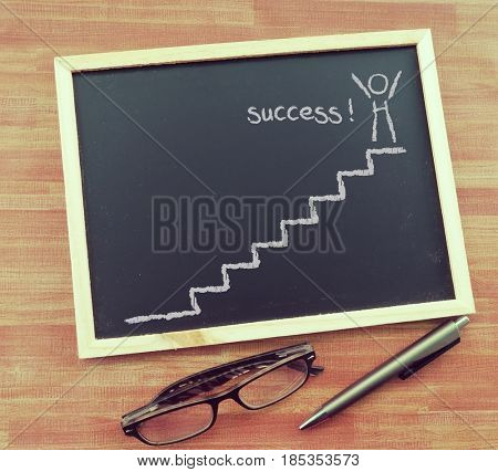 Chalkboard, businessman at the top of stairs
