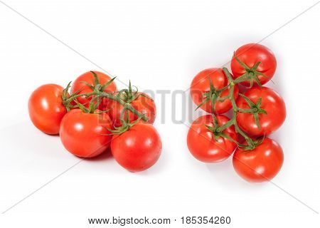 Fresh branch of Tomatoes isolated on white background with clipping path.