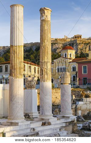 Acropolis and remains of Hadrian's Library in the old town of Athens, Greece.