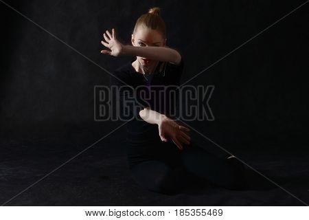 Vogue Dancer Posing On Dark Background