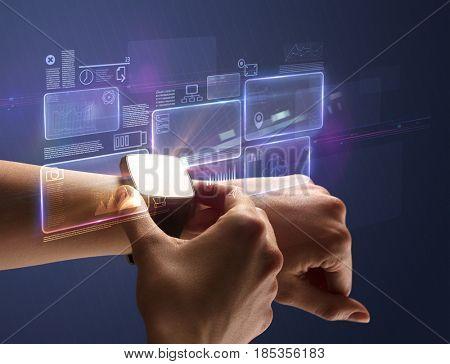 Female hand wearing smartwatch with statement labels around and dark background