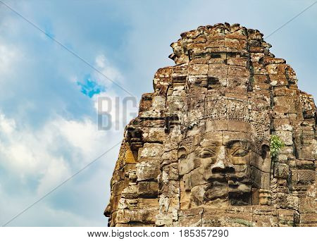 Smiling stone faces of Prasat Bayon the central temple of Angkor Thom Complex, Siem Reap, Cambodia. Ancient Khmer architecture and famous Cambodian landmark, World Heritage.