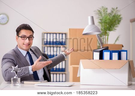 Young handsome businessman moving offices