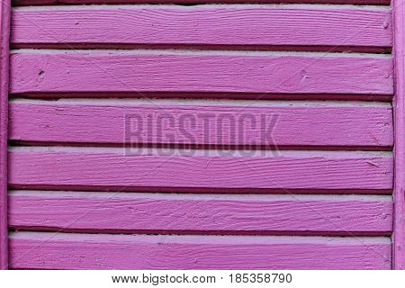 old vintage pink texture wall. wooden background