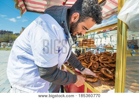 ISTANBUL-APRIL 08: Snack seller at sultanahmet square. Istanbul is one of the most popular destinations in the world. On April 08, 2015 in Istanbul, Turkey