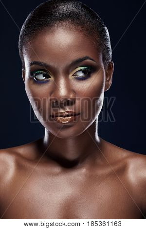 Portrait Of Beautiful African American Woman Looking To The Side. Studio Portrait On A Dark Backgrou