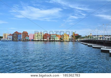 WILLEMSTAD CURACAO - MARCH 27 2017: Waterfront with harbour and colorful houses in Willemstad Caribbean. The city center is UNESCO World Heritage Site.