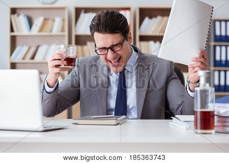 Businessman drinking in the office