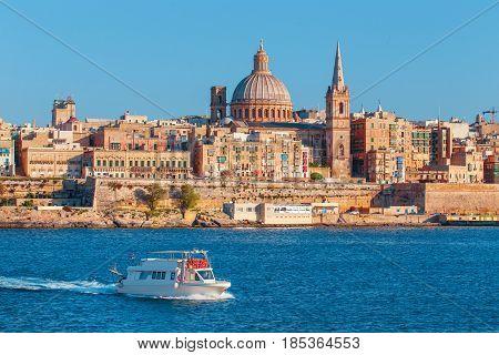 Valletta citiscape with bay cruise boat Malta EU