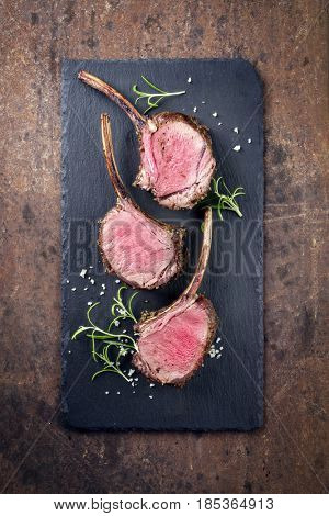 Rare Barbecue Rack of Venison as top view on a black slate
