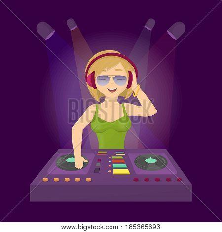 Cool dj in club. Woman in headphones djing in the dance club.