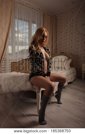 Woman With Perfect Body Wearing Military Jacket Hight Gray Socka And Panties Sit Near Bed. Provocati