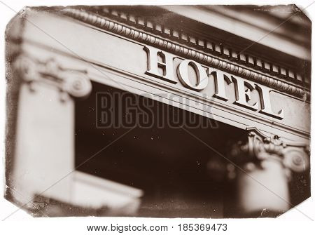 Hotel word with majestic letters on luxury five star hotel with beautiful columns - vintage photo