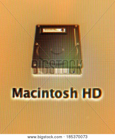 FRANKFURT GERMANY - SEPT 11 2011: Visually impaired screen activation Macintosh HD hard drive icon seen on an iMac computer digital blue screen